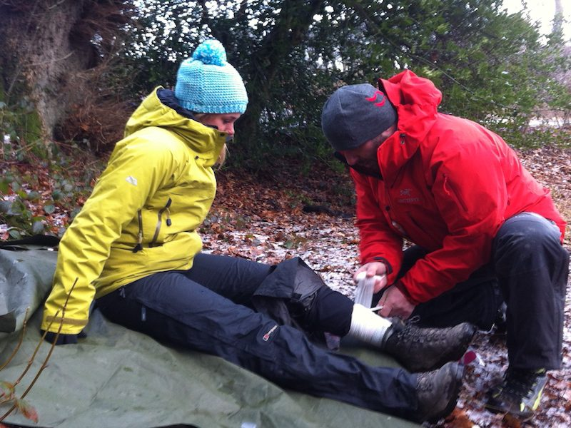 Bandaging a leg outdoors